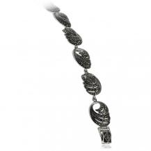 Stříbrný náramek posázený markazity, spirálovitý motiv