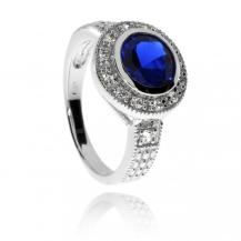 Stříbrný prsten se zirkony (cubic zirconia) - modrý středový kámen
