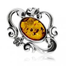 Stříbrná brož - Oválný jantar v ozdobném lůžku